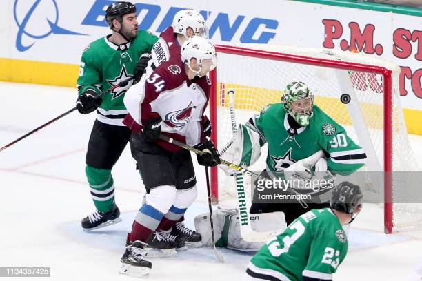 Ben Bishop of the Dallas Stars blocks a shot against Carl Soderberg of the Colorado Avalanche in the third period at American Airlines Center on...
