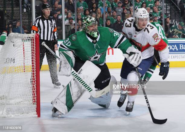 Ben Bishop of the Dallas Stars defends his net against Dryden Hunt of the Florida Panthers at the American Airlines Center on March 19 2019 in Dallas...