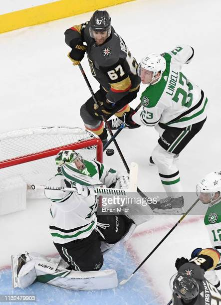 Ben Bishop of the Dallas Stars makes a save on a shot by Max Pacioretty of the Vegas Golden Knights as Esa Lindell of the Stars defends in the first...