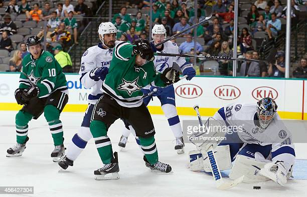 Ben Bishop of the Tampa Bay Lightning blocks a shot on goal from Vernon Fiddler of the Dallas Stars as Jason Garrison of the Tampa Bay Lightning...