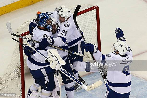 Ben Bishop of the Tampa Bay Lightning celebrates with his teammagtes after defeating the New York Rangers by a score of 20 to win Game Seven of the...