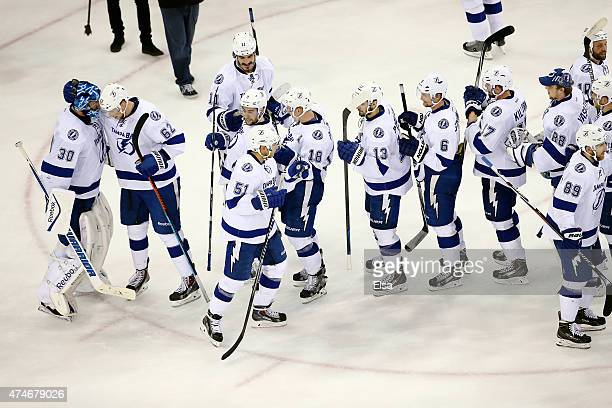 Ben Bishop of the Tampa Bay Lightning celebrates with his teammates after defeating the New York Rangers 2 to 0 in Game Five of the Eastern...
