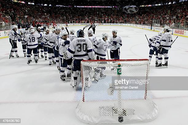Ben Bishop of the Tampa Bay Lightning celebrates with his teammates after defeating the Chicago Blackhawks 32 in Game Three of the 2015 NHL Stanley...