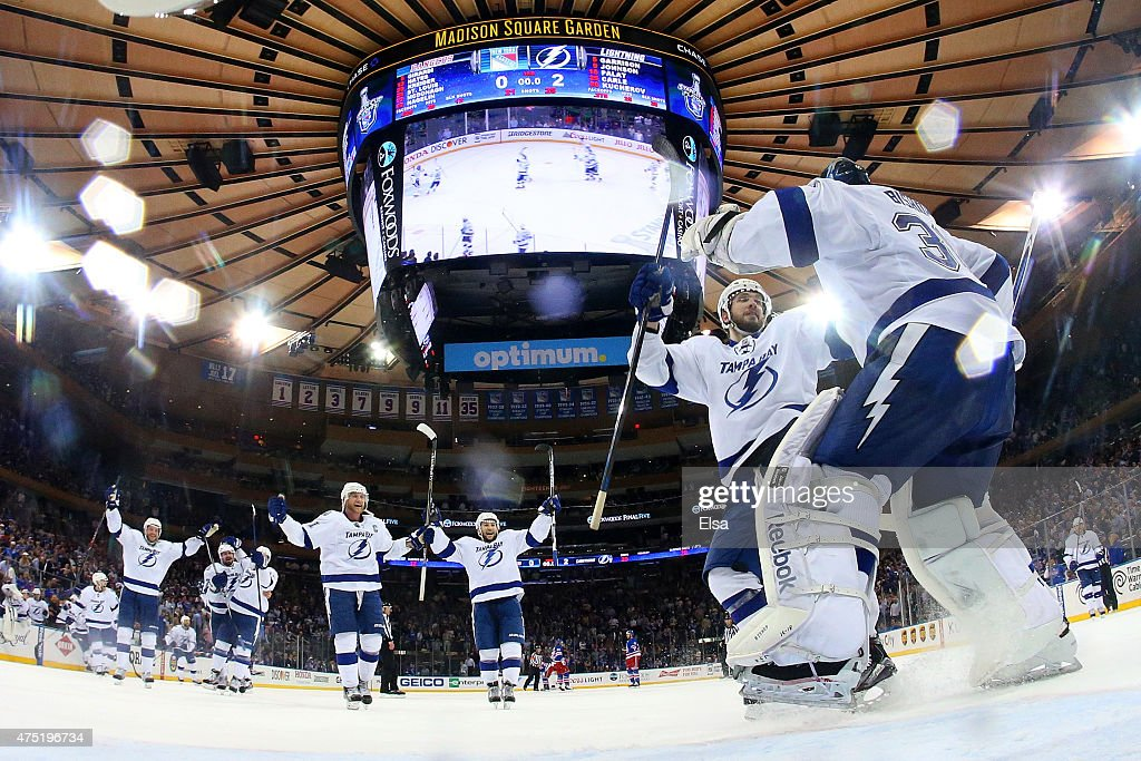 Ben Bishop #30 of the Tampa Bay Lightning celebrates with teammate Nikita Kucherov #86 after defeating the New York Rangers by a score of 2-0 to win Game Seven of the Eastern Conference Finals during the 2015 NHL Stanley Cup Playoffs at Madison Square Garden on May 29, 2015 in New York City.
