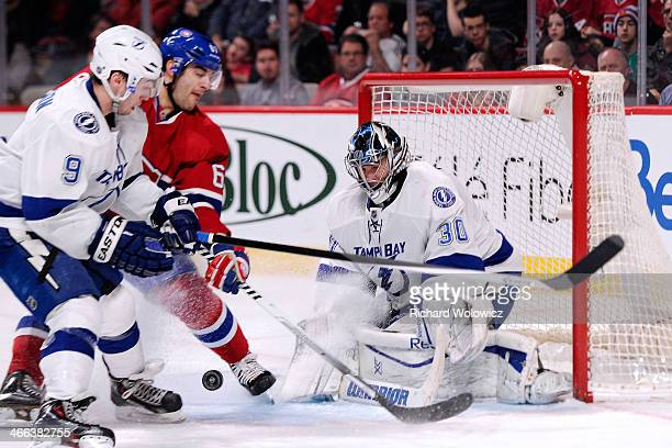 Ben Bishop of the Tampa Bay Lightning gets down to stop the puck on an attempt by Max Pacioretty of the Montreal Canadiens during the NHL game at the...