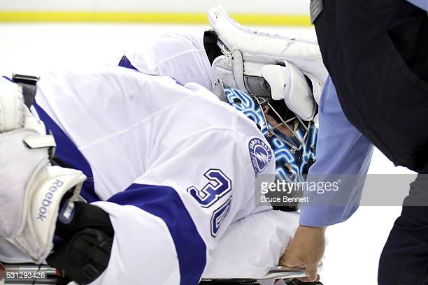 Ben Bishop of the Tampa Bay Lightning is carted off the ice after a play at the net during the first period against the Pittsburgh Penguins in Game...
