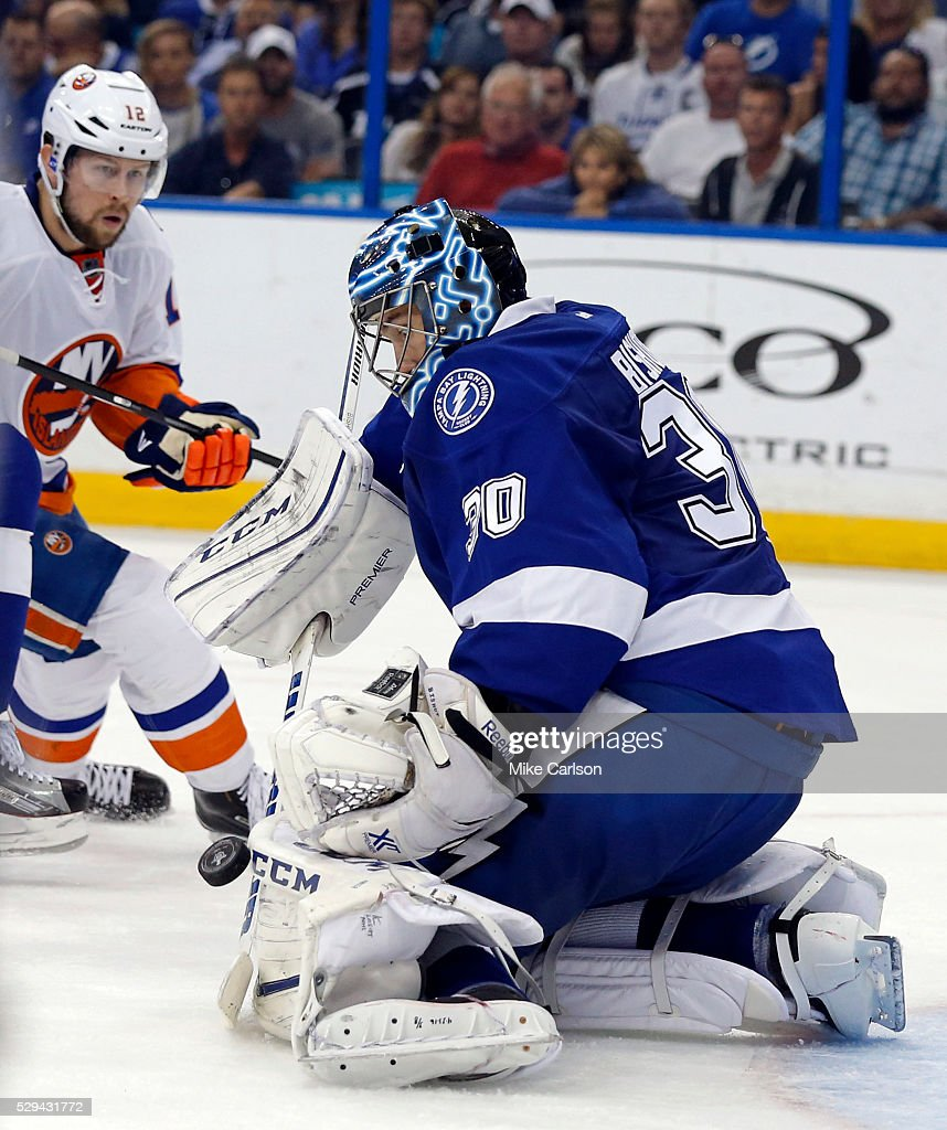 Ben Bishop #30 of the Tampa Bay Lightning makes a save against \Josh Bailey #12 of the New York Islanders during the third period of Game Five of the Eastern Conference Second Round during the 2016 NHL Stanley Cup Playoffs at Amalie Arena on May 8, 2016 in Tampa, Florida.