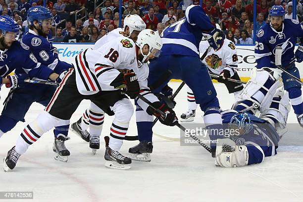 Ben Bishop of the Tampa Bay Lightning makes a save against Marcus Kruger of the Chicago Blackhawks during the first period in Game Two of the 2015...