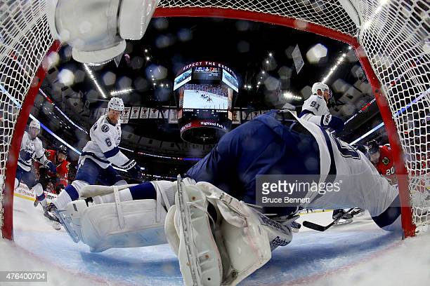 Ben Bishop of the Tampa Bay Lightning makes a save against the Chicago Blackhawks during Game Three of the 2015 NHL Stanley Cup Final at the United...