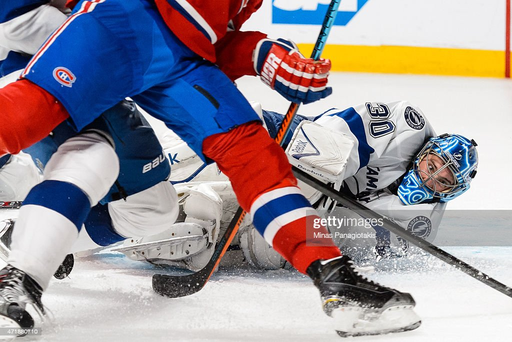 Ben Bishop #30 of the Tampa Bay Lightning makes a save during the first overtime period in Game One of the Eastern Conference Semifinals against the Montreal Canadiens during the 2015 NHL Stanley Cup Playoffs at the Bell Centre on May 1, 2015 in Montreal, Quebec, Canada.