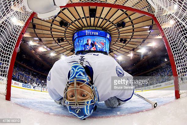 Ben Bishop of the Tampa Bay Lightning stretches before the start of Game One of the Eastern Conference Finals against the New York Rangers during the...