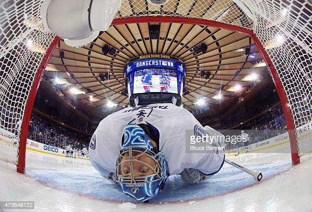 Ben Bishop of the Tampa Bay Lightning stretches before the start of the third period in Game One of the Eastern Conference Finals against the New...