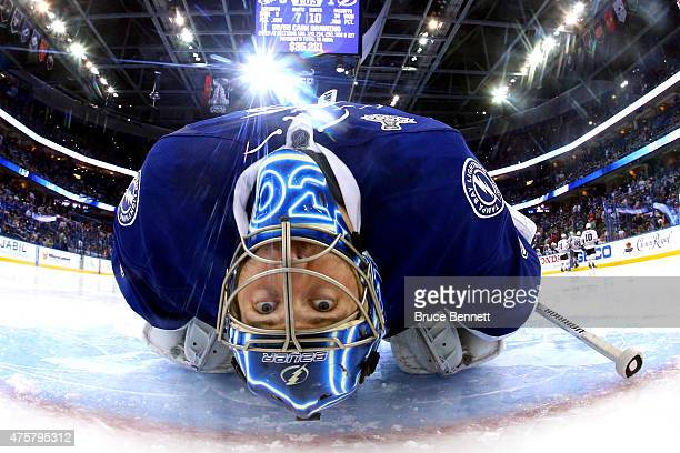 Ben Bishop of the Tampa Bay Lightning stretches during a break in play in between the second period and third period against the Chicago Blackhawks...