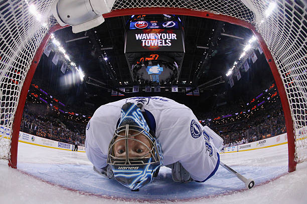 Ben Bishop of the Tampa Bay Lightning stretches prior to the game against...