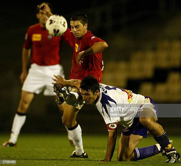 Ben Blake of the Wolves and Shaun Murphy of Perth in action during round ten of the NSL between the Wollongong Wolves and Perth Glory at WIN Stadium...