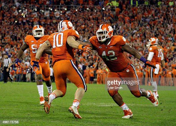 Ben Boulware of the Clemson Tigers and Christian Wilkins react after making a stop late in the game against the Florida State Seminoles at Memorial...