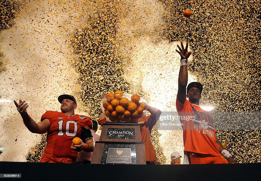 Ben Boulware #10 of the Clemson Tigers and Deshaun Watson #4 celebrate after the Clemson Tigers defeat the Oklahoma Sooners with a score of 37 to 17 to win the 2015 Capital One Orange Bowl at Sun Life Stadium on December 31, 2015 in Miami Gardens, Florida.