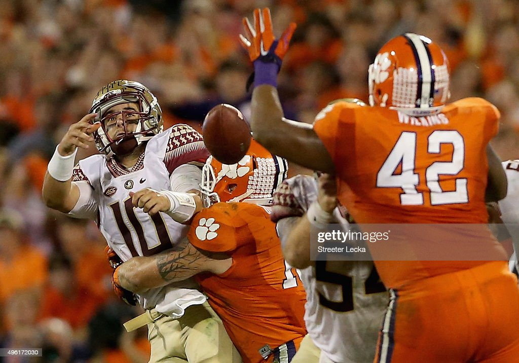 Ben Boulware #10 of the Clemson Tigers hits Sean Maguire #10 of the Florida State Seminoles during their game at Memorial Stadium on November 7, 2015 in Clemson, South Carolina.
