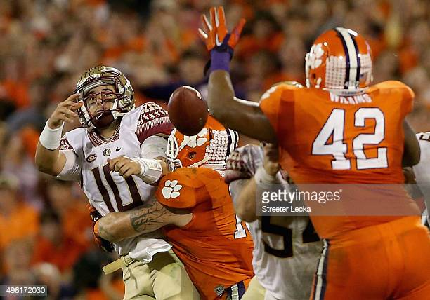 Ben Boulware of the Clemson Tigers hits Sean Maguire of the Florida State Seminoles during their game at Memorial Stadium on November 7 2015 in...