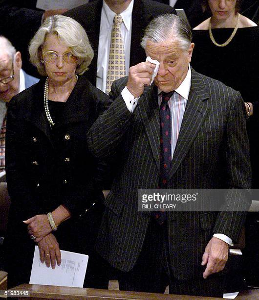 Ben Bradlee former executive editor of the Washington Post wipes his eyes as his wife Post writer Sally Quinn stands by during funeral services 23...