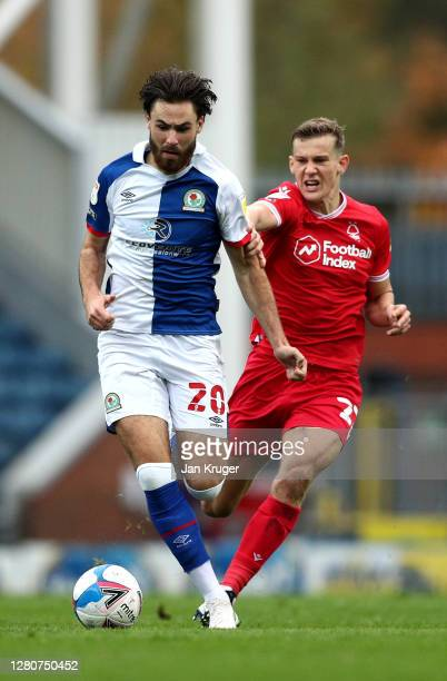 Ben Brereton of Blackburn Rovers battles with Ryan Yates of Nottingham Forest during the Sky Bet Championship match between Blackburn Rovers and...