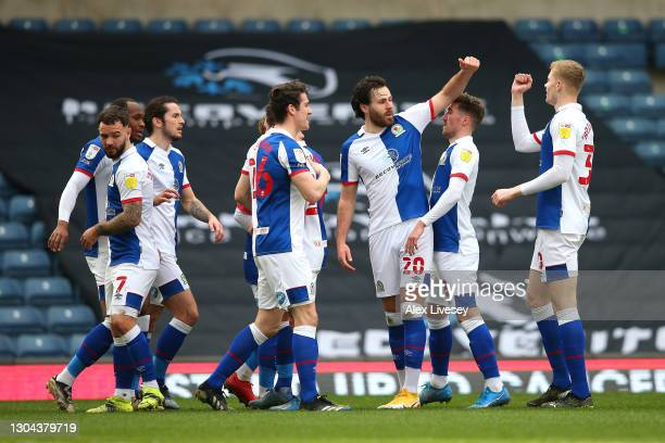Ben Brereton of Blackburn Rovers celebrates with teammates after scoring his team's first goal during the Sky Bet Championship match between...