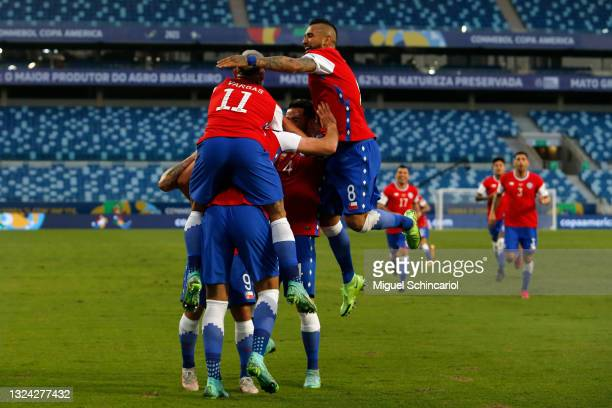Ben Brereton of Chile celebrates with teammates after scoring the first goal of his team during a group A match between Chile and Bolivia as part of...