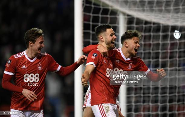 Ben Brereton of Nottingham Forest celebrates scoring his team's third goal from the penalty spot with Matthew Cash and Kieran Dowell during The...