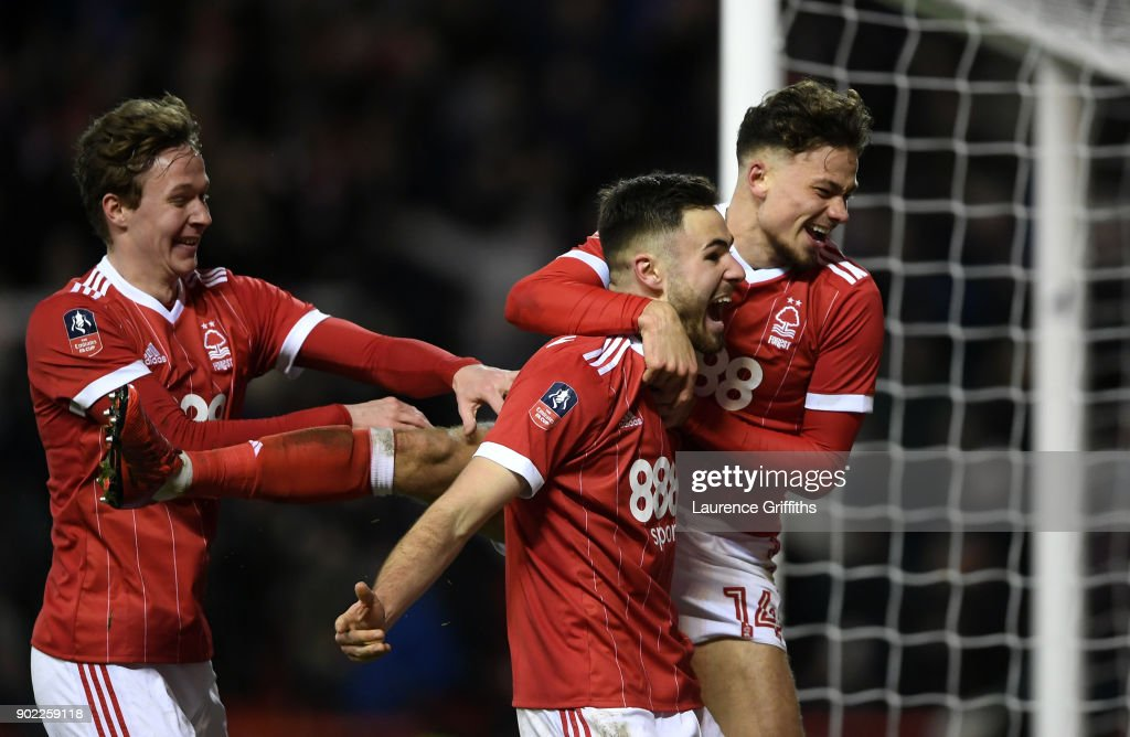 Ben Brereton (C) of Nottingham Forest celebrates scoring his team's third goal from the penalty spot with Matthew Cash (R) and Kieran Dowell (L) during The Emirates FA Cup Third Round match between Nottingham Forest and Arsenal at City Ground on January 7, 2018 in Nottingham, England.
