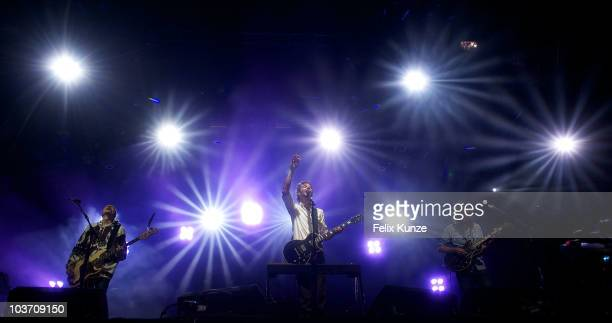 Ben Bridwell Bill Reynolds and Tyler Ramsey of US rock group Band of Horses performs on day three of the Reading Festival at Richfield Avenue on...