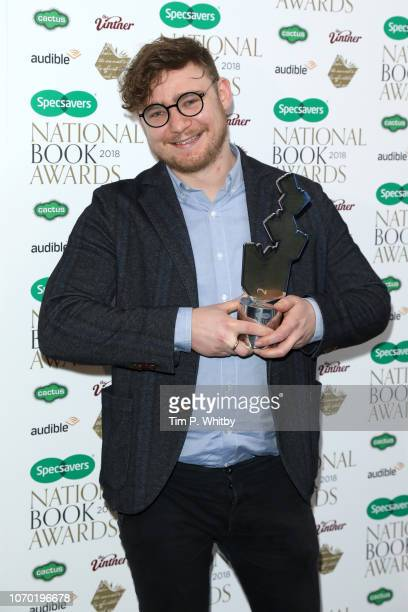 Ben Brooks author of 'Stories for Boys Who Dare to be Different' with the award for Children's Book of the Year at the National Book Awards at RIBA...