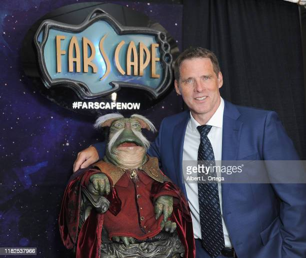 Ben Browder poses next to Rygel at Farscape - The Uncharted Territories: A 20th Anniversary Celebration held at Jim Henson Studios on October 19,...