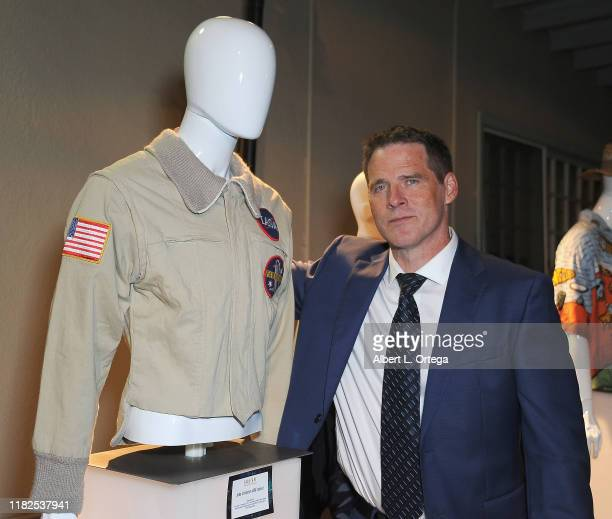 Ben Browder poses with costume and artifacts at Farscape - The Uncharted Territories: A 20th Anniversary Celebration held at Jim Henson Studios on...