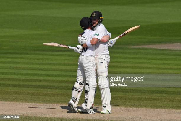 Ben Brown and Ollie Robinson of Sussex celebrate together after steering their team to victory during the Specsavers County Championship Division Two...