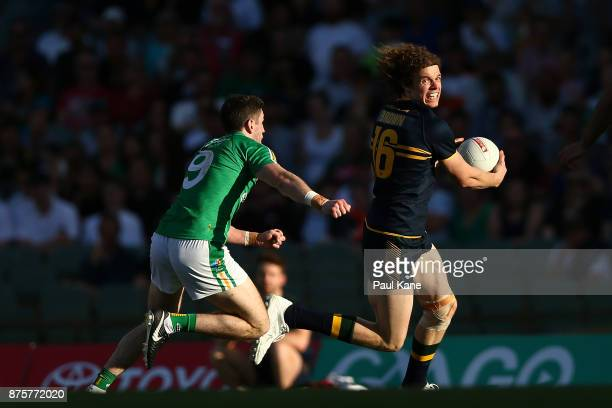 Ben Brown of Australia runs clear of Paul Geaney of Ireland during game two of the International Rules Series between Australia and Ireland at Domain...