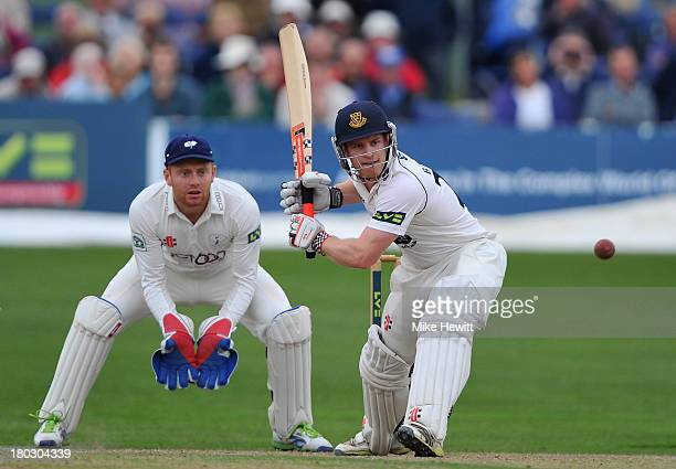 Ben Brown of Sussex hits outs Jonny Bairstow of Yorkshire looks on during the LV County Championship match between Sussex and Yorkshire at...