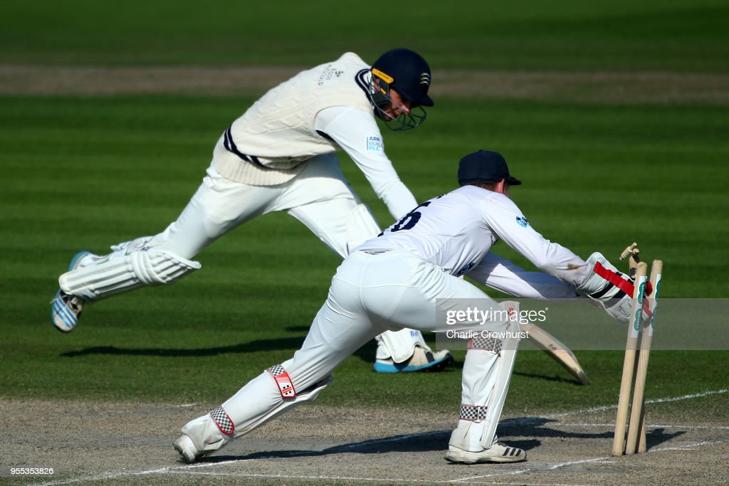 Ben Brown of Sussex runs out Tom Barber of Middlesex during day three of the Specsavers County Championship: Division Two match between Sussex and Middlesex at The 1st Central County Ground on May 6, 2018 in Hove, England.