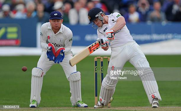 Ben Brown of Sussex square cuts for four as wicketkeeper Jonny Bairstow of Yorkshire looks on during the LV County Championship match between Sussex...