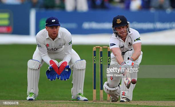 Ben Brown of Sussex sweeps as wicketkeeper Jonny Bairstow of Yorkshire looks on during the LV County Championship match between Sussex and Yorkshire...