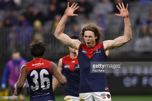 Ben Brown of the Demons celebrates a goal during the round 21 AFL match between West Coast Eagles and Melbourne Demons at Optus Stadium on August 09,...