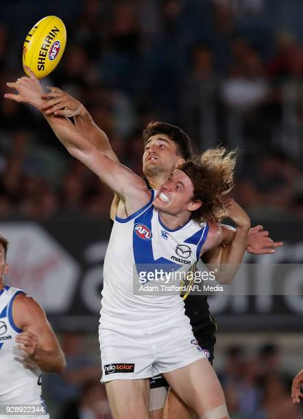 Ben Brown of the Kangaroos and Ivan Soldo of the Tigers compete for the ball during the AFL 2018 JLT Community Series match between the Richmond...