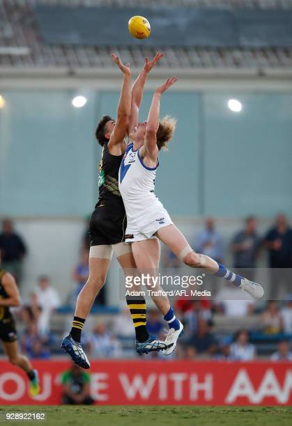 Ben Brown of the Kangaroos and Ivan Soldo of the Tigers compete in a ruck contest during the AFL 2018 JLT Community Series match between the Richmond...