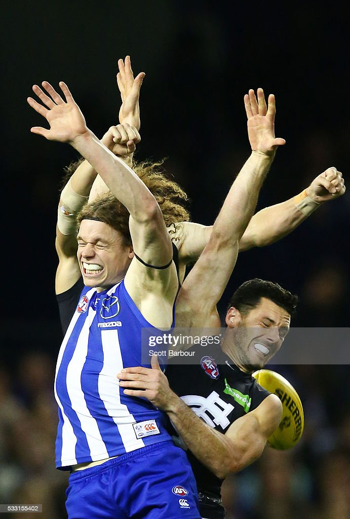 Ben Brown of the Kangaroos and Simon White of the Blues compete for the ball during the round nine AFL match between the North Melbourne Kangaroos and the Carlton Blues at Etihad Stadium on May 21, 2016 in Melbourne, Australia.