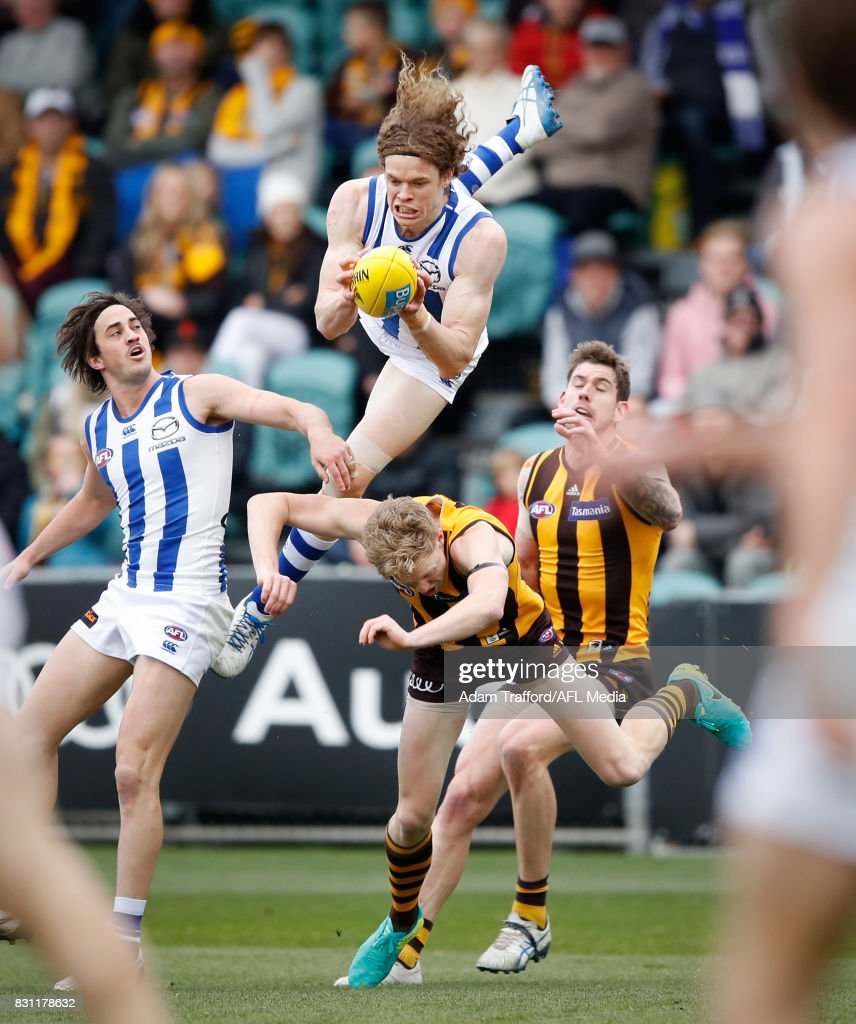 Ben Brown of the Kangaroos attempts to mark over Will Langford of the Hawks during the 2017 AFL round 21 match between the Hawthorn Hawks and the North Melbourne Kangaroos at the University of Tasmania Stadium on August 13, 2017 in Launceston, Australia.