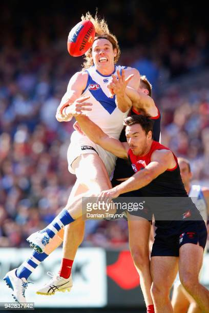 Ben Brown of the Kangaroos attempts to mark the ball during the round three AFL match between the Melbourne Demons and the North Melbourne Kangaroos...