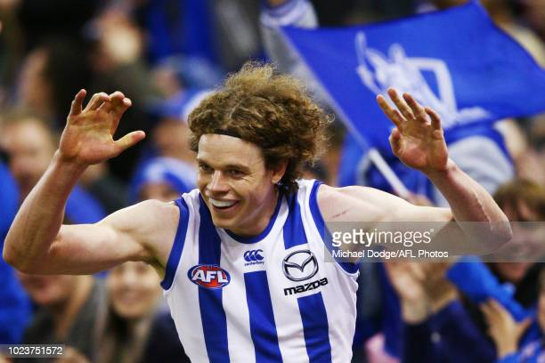 Ben Brown of the Kangaroos celebrates a goal during the round 23 AFL match between the St Kilda Saints and the North Melbourne Kangaroos at Etihad...