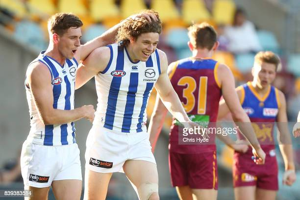 Ben Brown of the Kangaroos celebrates a goal during the round 23 AFL match between the Brisbane Lions and the North Melbourne Kangaroos at The Gabba...
