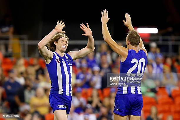Ben Brown of the Kangaroos celebrates a goal during the round five AFL match between the Gold Coast Suns and the North Melbourne Kangaroos at...
