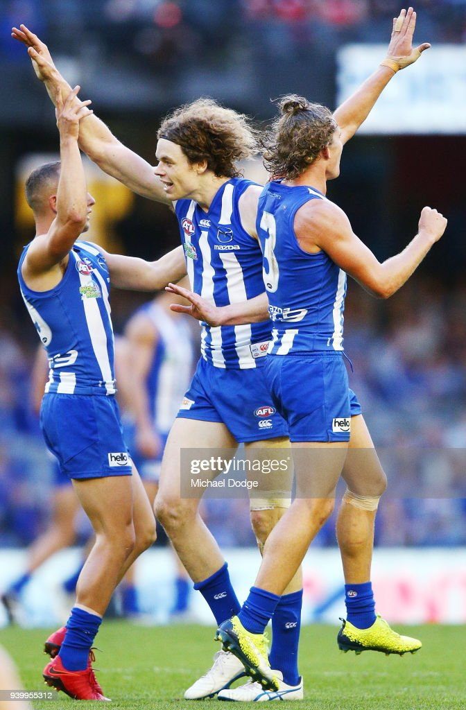 Ben Brown of the Kangaroos (C) celebrates a goal during the round two AFL match between the North Melbourne Kangaroos and the St Kilda Saints at Etihad Stadium on March 30, 2018 in Melbourne, Australia.
