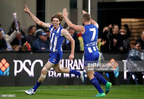 Ben Brown of the Kangaroos celebrates a goal with Jack Ziebell of the Kangaroos during the 2018 AFL Round 04 match between the North Melbourne...